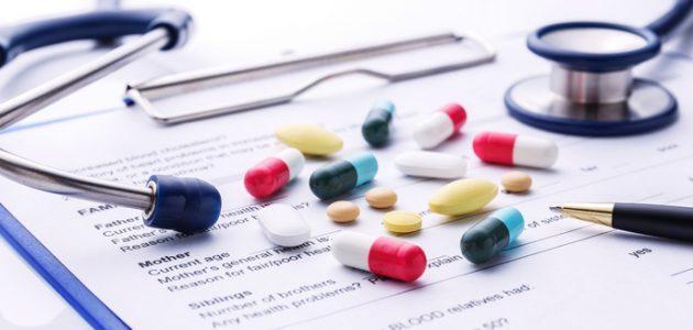 Medicine on stethoscope on clipboard